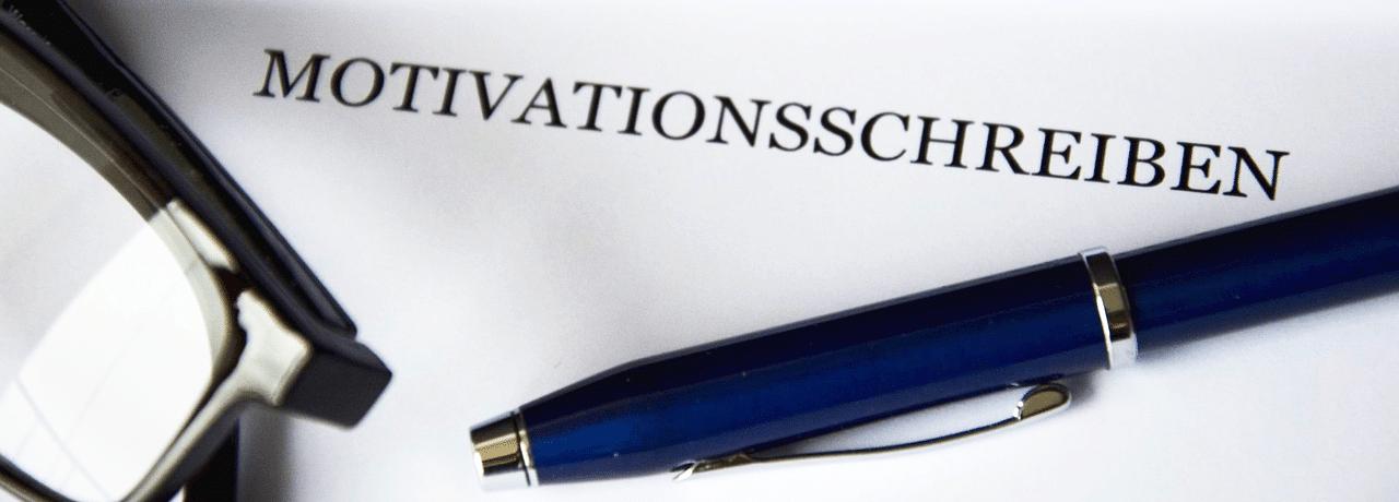 Motivationsschreiben mit Stift