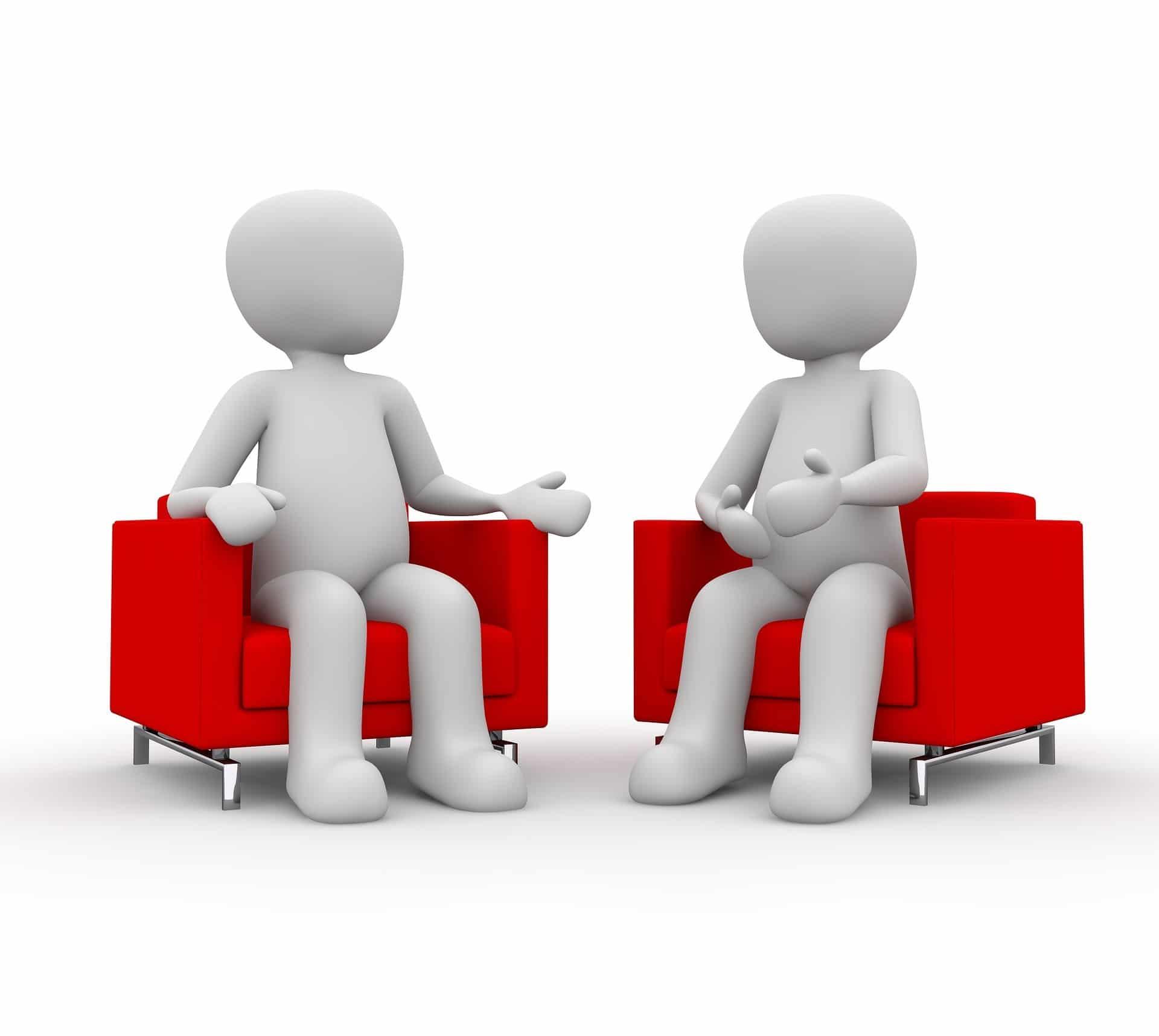 Gespräch zwischen zwei Figuren auf Sesseln